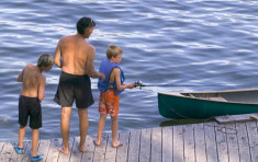 Family fishing off the dock at Elkins Resort