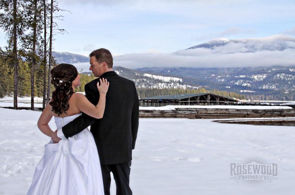 Image of wedding couple on snowy beach