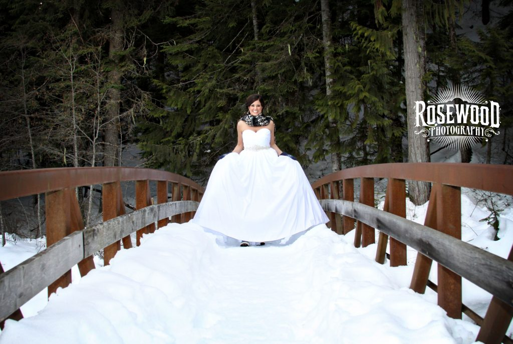 image of woman in wedding dress on a bridge
