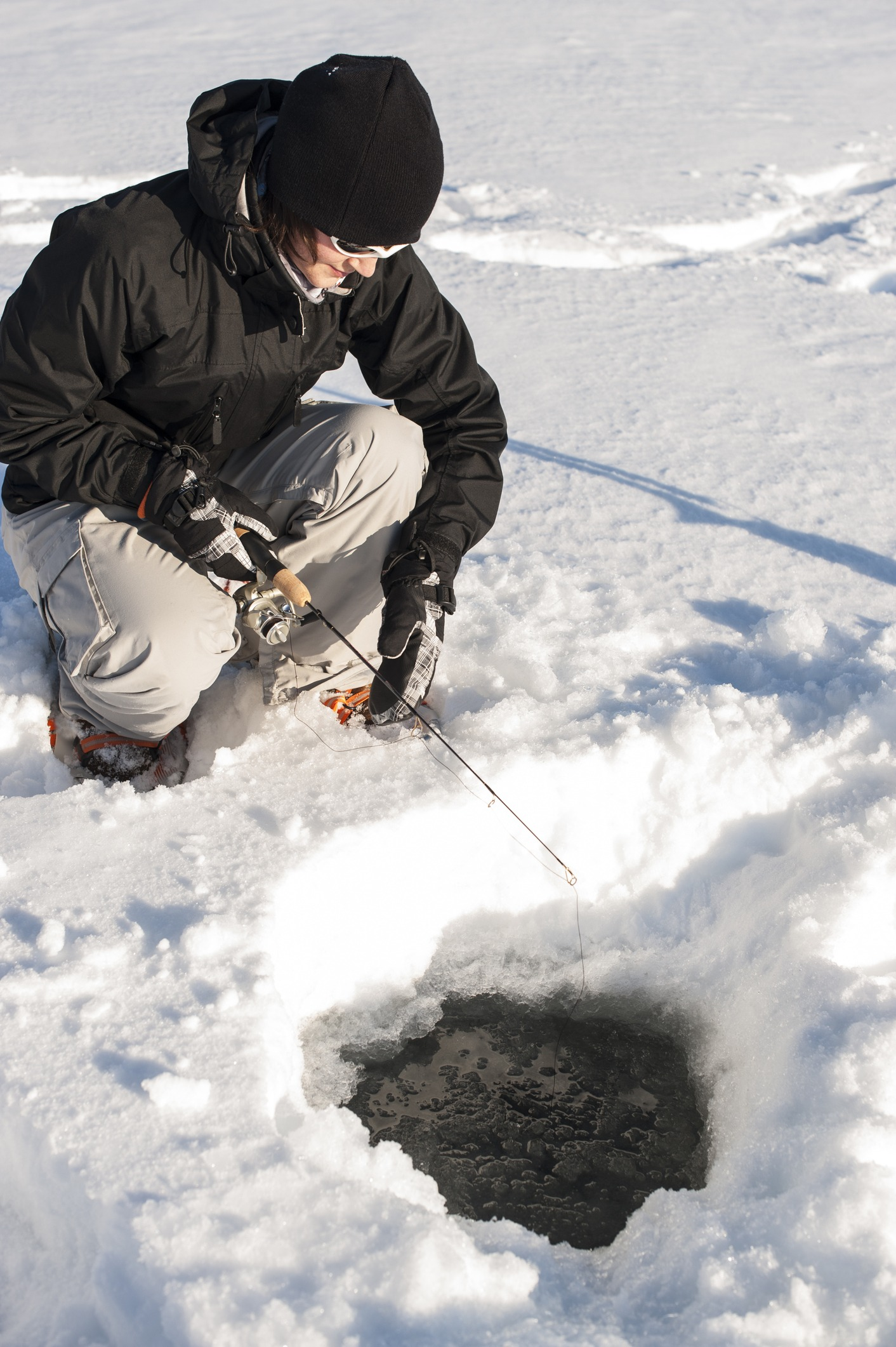 image of ice fishing at priest lake